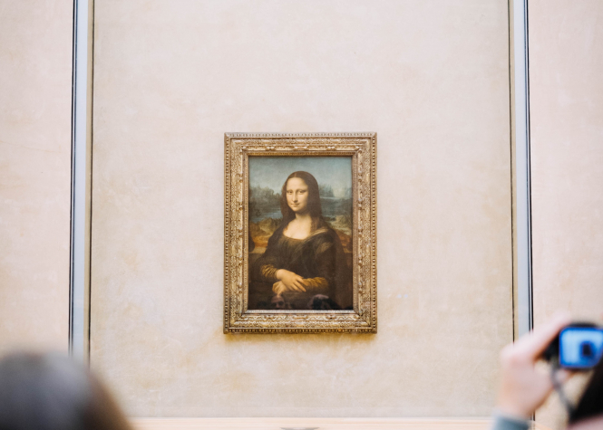 """If you want to raise an enigmatic smile during any troubling situation, then there is always the Mona Lisa"" says Nabila Ramdani. Pictured: Mona Lisa amongst the crowd at Louvre Museum, Paris, France"