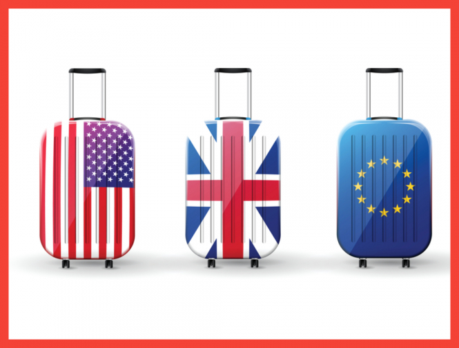 Suitcases with EU, UK and US flags