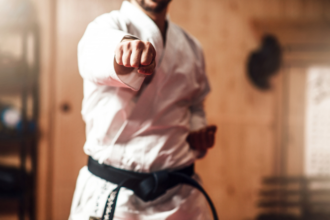 An image of a karate black belt during a session in a gym