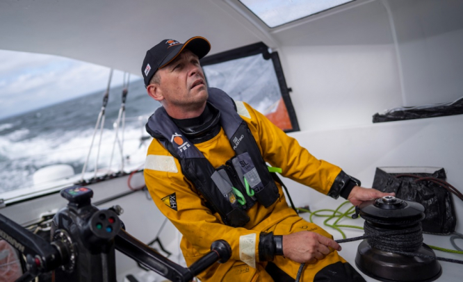 Sailor Kevin Escoffier sailing in a yacht. Vendee Globe: French sailor Escoffier found 'safe and sound' after epic rescue mission