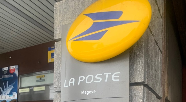 La Poste logo outside a branch. La Poste hires 9,000 new staff in France in Christmas run-up