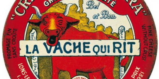 An old elaborate packaging of La Vache Qui Rit cheese. French spreadable cheese La Vache Qui Rit celebrates 100th year