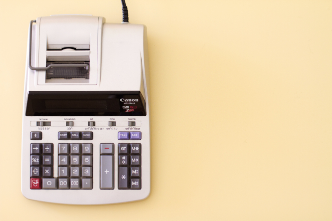 Learn how to protect your pension from tax penalties. Pictured: a ten key accounting calculator.