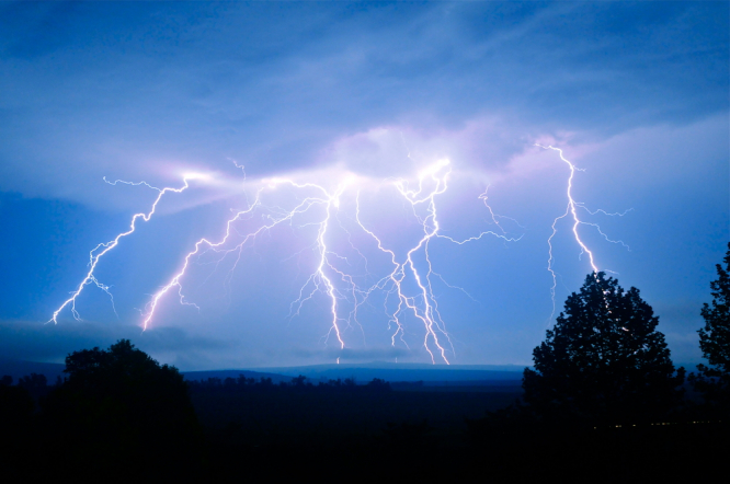 Lightning over countryside. Orange alert for storms in northwest and central France