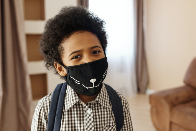 Little boy wearing a face mask. French parents' appeal for no masks in school rejected