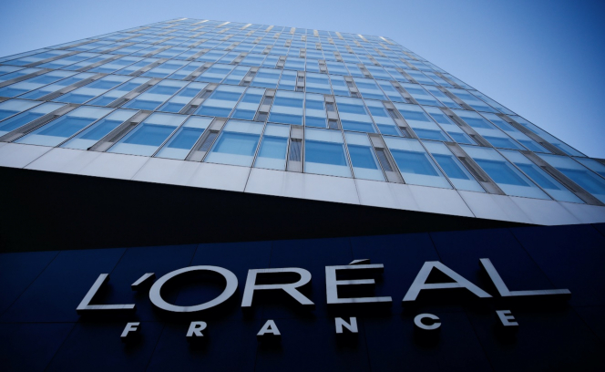 The L'Oreal logo on the front of a tall building. French giant L'Oreal removes 'whitening' words from skincare