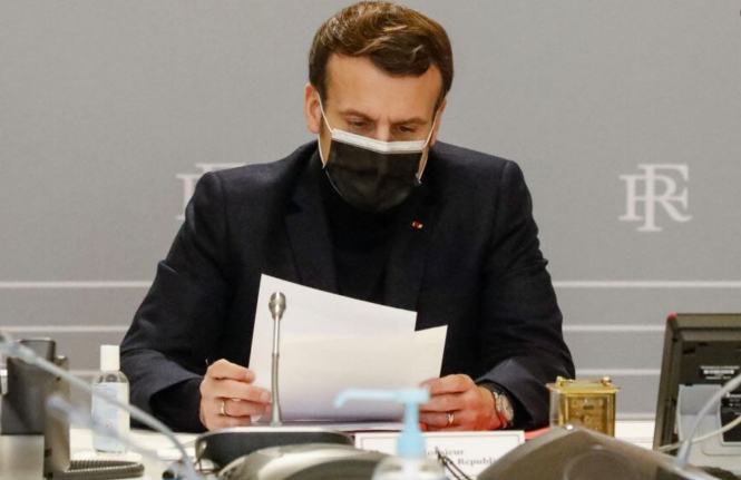 President Macron during a defence council meeting. No new Covid rules this week as France in 'in-between stage'