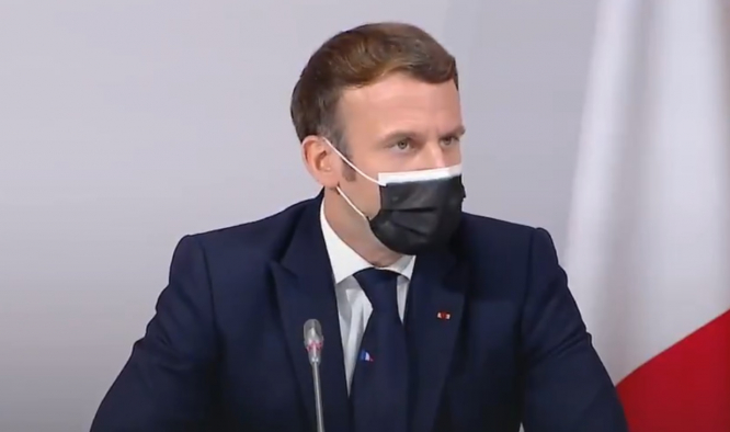 President Macron speaks at the meeting wearing a mask. Macron: France may hold referendum on climate change laws