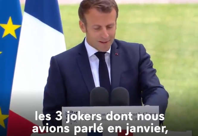 President Macron speaks in the Elysee garden. French President drops climate idea to lower motorway speed