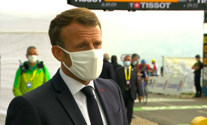 President Macron wearing a mask at he attends the Tour de France.