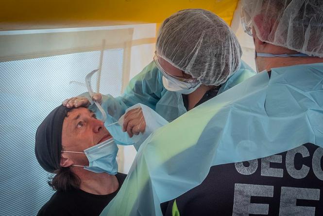 Man getting nasal swab in Strasbourg. Covid-19 antigen tests available soon in French pharmacies