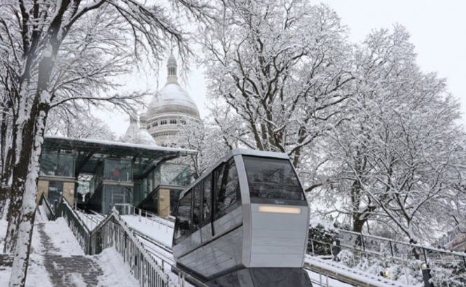 Snow falls on Montmartre in Paris. Watch: Snow and ski joy in Paris...but mountains stay closed