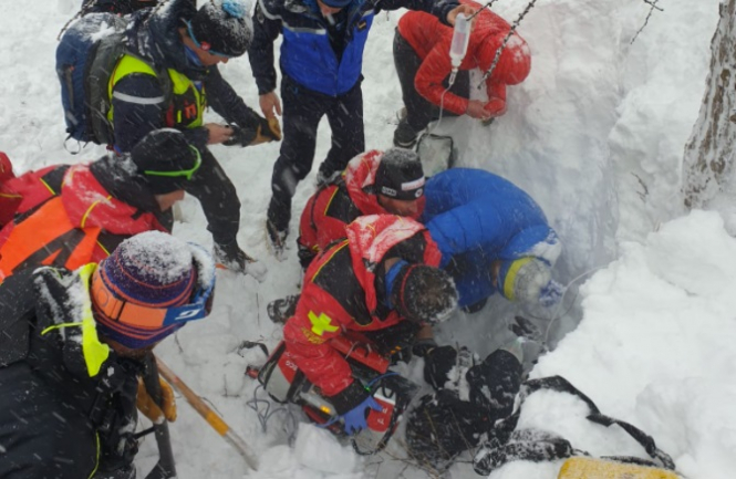 Rescuers on the scene. 'Miracle': Skier found alive in French Alps after avalanche
