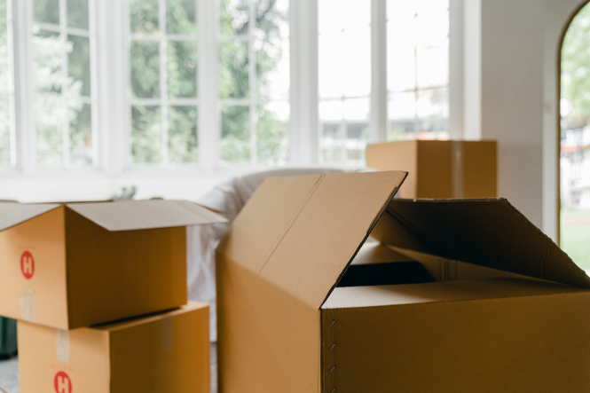 Packing boxes to move house. France lockdown: Can I move home from the UK to France?