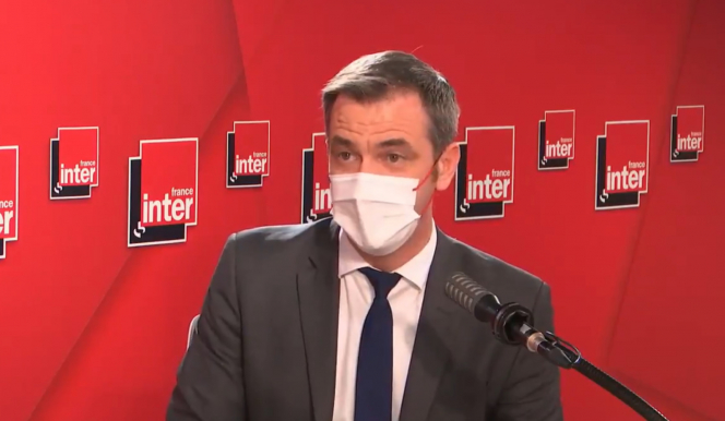 Health Minister Olivier Veran wearing a mask while being interviewed on France Inter. France Covid: Delta 'dominant within days', new measures under review