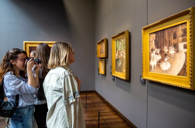 Women looking at a painting in a gallery