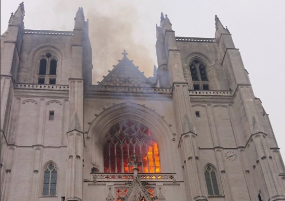 Nantes Cathedral in flames. Nantes Cathedral fire: Man questioned as inquiry continues