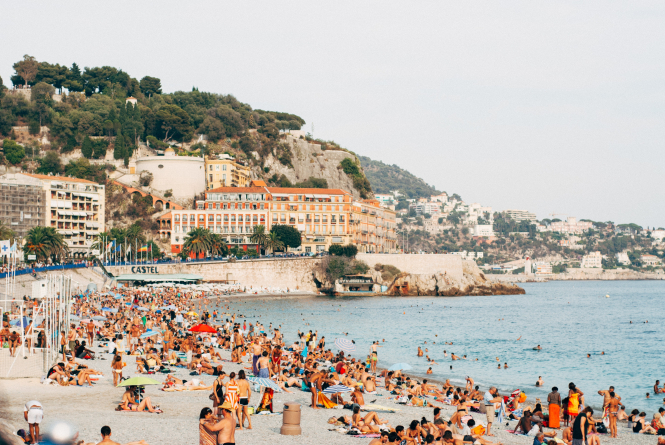 People on the beach in Nice, France. Travel between France and England is now possible as the UK government lifts quarantine measures from July 10.