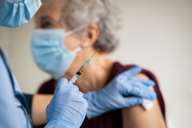 Older person getting vaccinated. Covid France: 114,000 in recent protests but 1.5 million get first jab