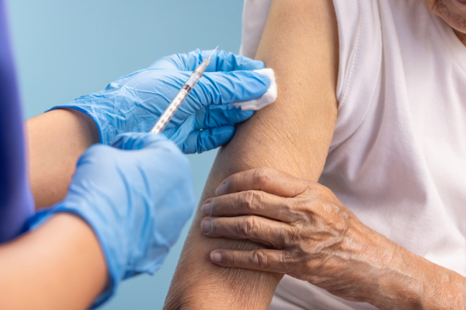 Older person getting vaccinated. Covid France: Five million vulnerable people still not vaccinated