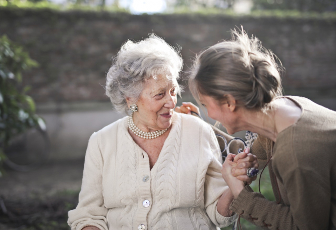 An older woman comforted by another woman. French neurologist Bruno Dubois 'hopeful' on early Alzheimer's research