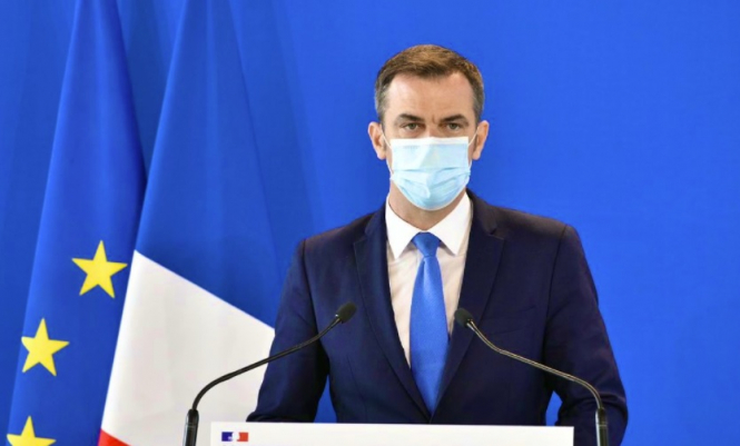 Health minister Olivier Veran wearing a mask. France at risk of Covid 'third wave' as cases still too high