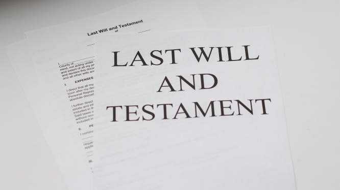 A piece of paper reads 'last will and testament'. Article: Must an English will be registered in France? Photo by Melinda Gimpel / Unsplash