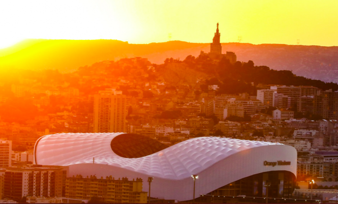 The sunsetting behind the Orange Vélodrome in Marseille. Immersive Rolling Stones exhibition set to open in Marseille in June