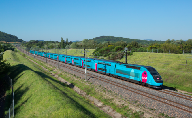 Ouigo train travelling through countryside. Five million discount TGV and other train tickets go on sale in France