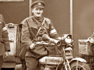 Army dispatch rider on motorcycle with pigeon hampers