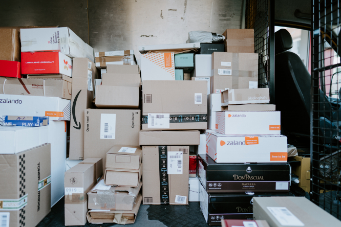 Parcels in van waiting to be delivered. France: 440% rise in online shopping scams in November