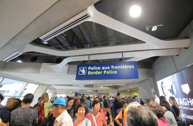 Passengers wait in line for police checks at a Paris airport. Paris airport head fears 'apocalyptic' delays due to Covid checks in summer