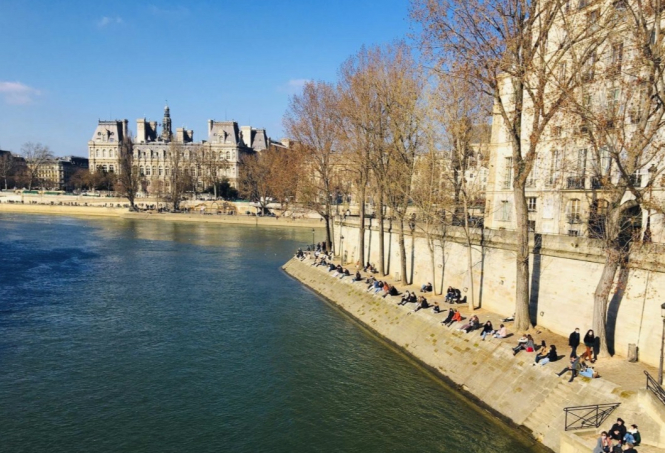 Parisians enjoy the spring weather in lockdown 3. New partial lockdown in France not enough say senior doctors
