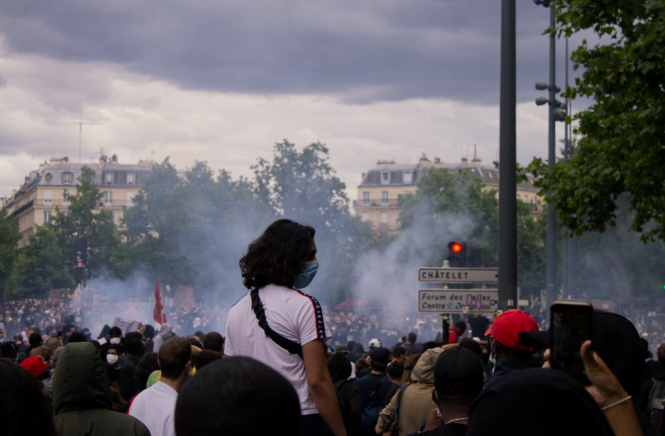 A man wearing a mask in a protest in Paris on June 13. France has legalised protests despite the ongoing health emergency