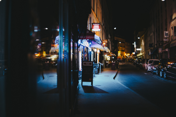 Paris street at night. Covid France: Fines, arrests for party-goers breaking curfew