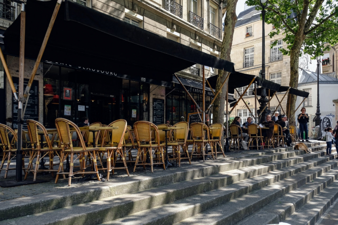 A restaurant terrace in Paris. Macron to confirm reopening dates for France in interview in coming days