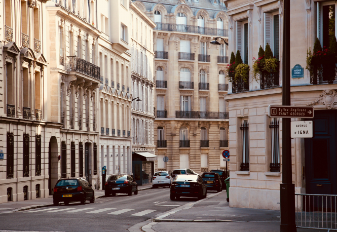 Cars on a road in Paris, France. Article: Parking fine relief for stolen car owners in France. Photo by Anh Q Tran / Unsplash