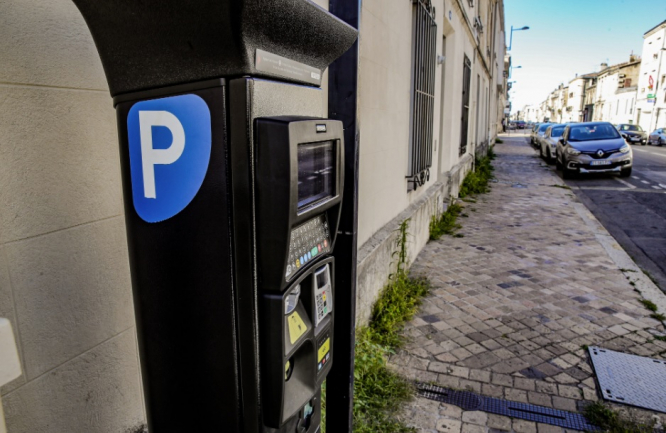 A parking meter in Bordeaux. Bordeaux city may charge residents for parking based on income