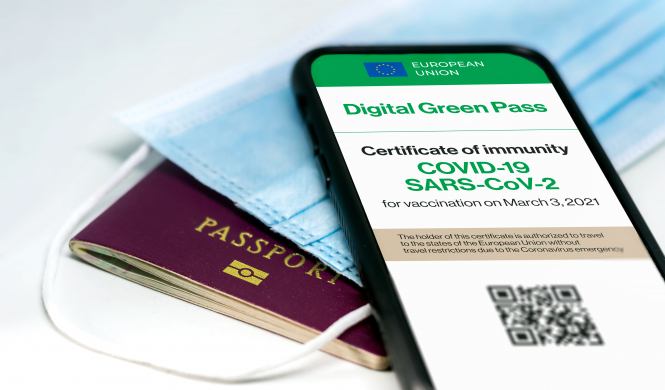 Passport, mask and digital health pass. EU Covid health pass approved for travel use from July 1
