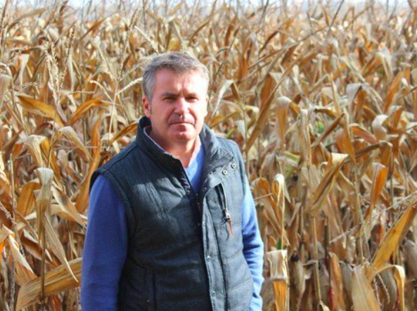 Paul François standing in a field. French farmer's long fight against Monsanto draws to close