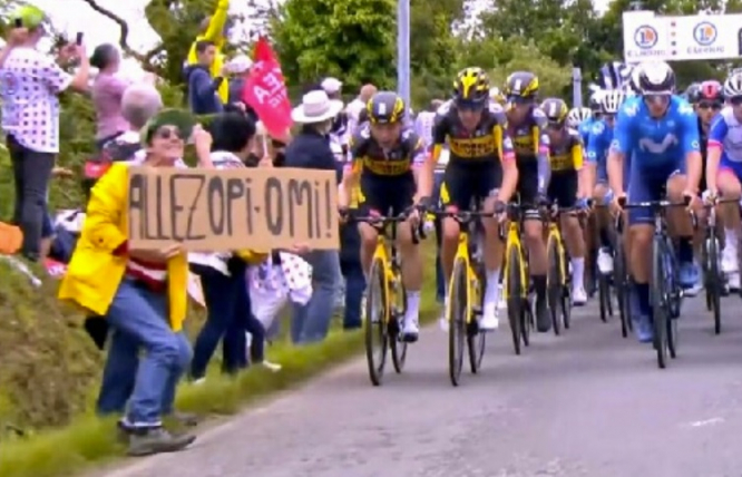 A photo of the woman holding up the sign at the Tour de France just before the crash. Tour de France crash: Authorities search for woman who caused pileup