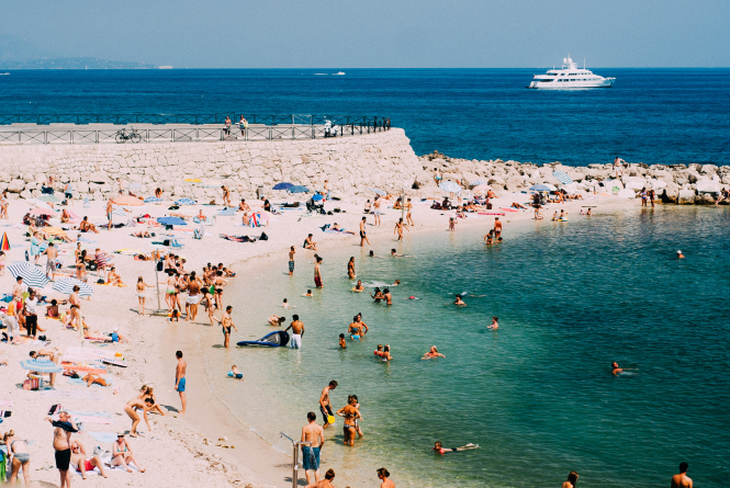 People on a beach in Antibes. France's cleanest beaches for 2020 have just been revealed by Pavillon Bleu