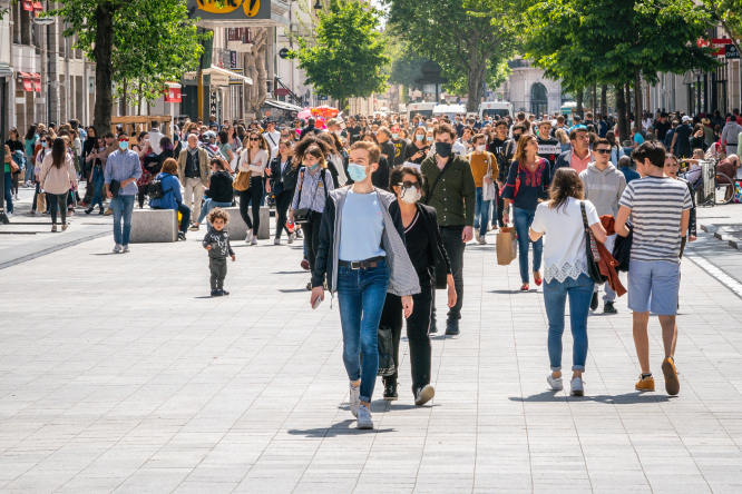 People on street in Lyon, some wearing masks. Covid France: When can we stop wearing face masks?