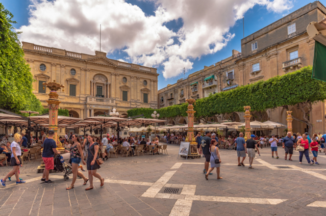 People walking through a square in Malta. Covid-19: France condemns Malta's decision to bar unvaccinated tourists