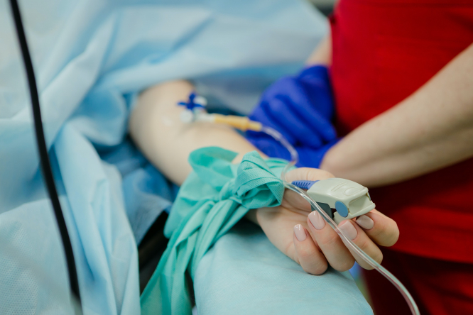 Person lying in intensive care bed. Paris: Hospitals to create 600 extra intensive care beds