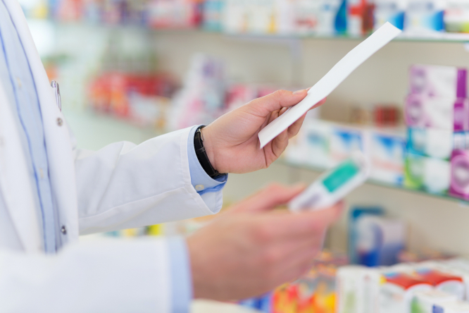 Pharmacist with prescription and medicine. French pharmacists now able to renew some doctor's prescriptions