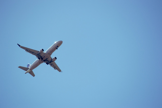 A plane flies in blue sky. Europe has confirmed the list of non-EU borders set to open on July 1
