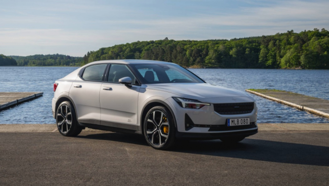 A Polestar 2 car by some water. Citroën blocks Polestar 2 in France over 'too-similar logo'