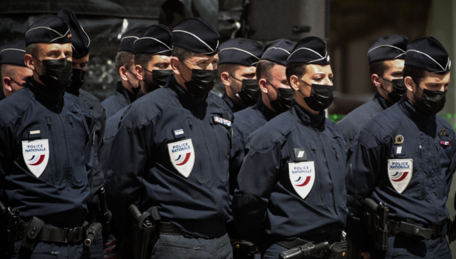 Police line up at the memorial for killed police officer Eric Masson. France doubles penalties for people who do not obey police instructions
