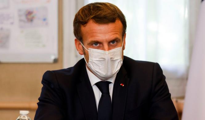 President Macron wearing a mask. President Macron to make Covid speech tonight